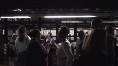 Different kinds of people on subway train platform in slow motion NYC Stock Footage