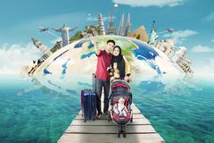 Stock Photo of Family travel the world monument