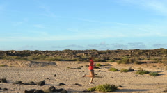 Determined Woman Running In Arid Landscape Stock Footage