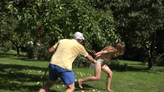 Man spray water woman Stock Footage