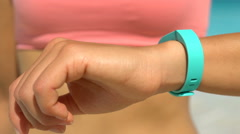Sporty Woman Checking Activity Tracker At Beach - Fitness Tracker Wearable Tech Stock Footage