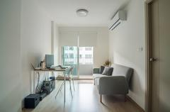 Living room with working space Stock Photos