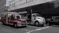 emergency FDNY fire truck ambulance siren driving on street in 4K NYC - stock footage