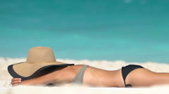 Young Woman Is Sunbathing On Shore At Beach - Summer Travel Holidays Concept Stock Footage