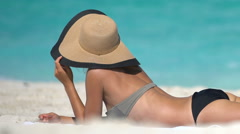 Woman Wearing Sunhat While Sunbathing At Beach - Summer Vacation Concept Stock Footage