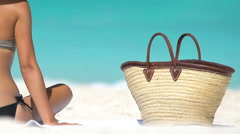 Woman Sitting By Beach Bag On Sand At Beach - Summer Travel Holidays Concept Stock Footage
