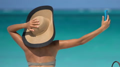 Woman Taking Selfie At Beach Against Sea - Summer Travel Holidays Concept - stock footage