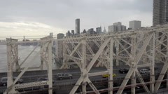 Queensboro Bridge with cars driving across East River, Manhattan skyline NYC Stock Footage