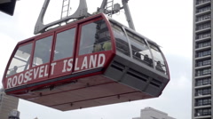 Roosevelt Island Tram leaving Manhattan over East River Queensboro Bridge NYC Stock Footage