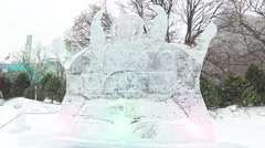 4k ice sculpture while beautiful snows falls Stock Footage