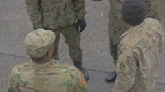 Group of Soldiers is Standing on a Square Talking Mixed Race Men is Camouflage Stock Footage