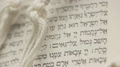 Hebrew Bible with Tallis Prayer Shawl Stock Footage