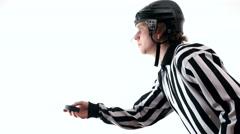 Hockey referee demonstrate hockey puck Stock Footage