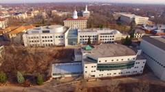 Prestigious University campus with spires, Aerial Flyover Stock Footage