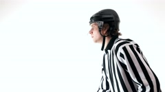 Hockey referee holding a puck in face off position Stock Footage