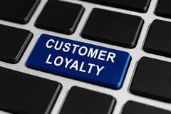 Customer loyalty button on keyboard Stock Photos