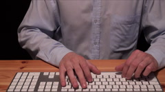 Businessman typing on a keyboard Stock Footage