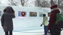 4k people look at ice sculpture art - stock footage