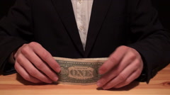 Businessman counting of one dollar bills United States of America on a table - stock footage