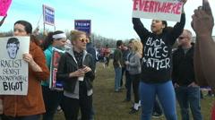"""No hate"" chanting protestors at a Donald Trump rally - stock footage"