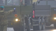 Pedestrians Crossing Road Before Nato Vehicle Atlantic Resolve Operation Poland - stock footage