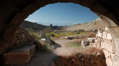 Ancient ruins of the stadium in Aphrodisias, Zoom from one of two entrances for Stock Footage