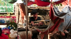 Young man polish jade on Machine near  market of Mandalay in Myanmar Stock Footage