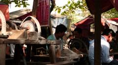 Jade machine finishing and polishing in Mandalay market of Myanmar Stock Footage