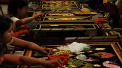 Hand embroidery with gold threads in Mandalay of Myanmar Stock Footage
