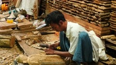 Artisan making Buddha statue from wood in Myanmar Stock Footage