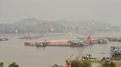 Irrawaddy river time lapse ships motion in Mandalay with pagodas background Stock Footage