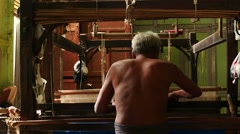 Man working on textile machine indoors - Myanmar, Mandalay city 2 Stock Footage