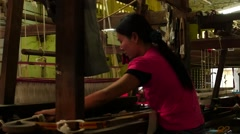 Women working on textile machine indoors  5 - Myanmar Stock Footage
