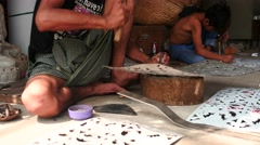 Workers produce hand made stencils for religious purposes - Myanmar Stock Footage
