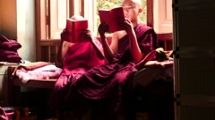Young monks read holy books in Mandalay monastery in Myanmar Stock Footage