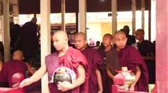 Monks motion after the breakfast closeup Mandalay monastery - stock footage