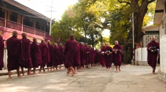 Monks formation and  parade near monastery in Myanmar - stock footage