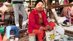 Middle age woman polishing a piece of jade in Myanmar - stock footage