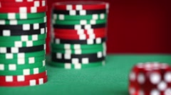 Red dice rolls and casino chips on green table Stock Footage