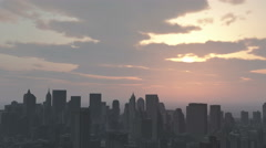 4k Urban sunset,cloud flying over New York,modern business building silhouette. Stock Footage