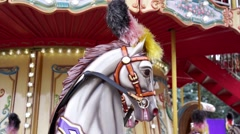 Close-up of merry-go-round carousel horse, low season, abandoned amusement park Stock Footage