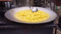 Appetizing sweet corn cooked outdoors in large bowl, barbecue party, street food Stock Footage
