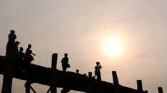 U Bein bridge in Myanmar silhouettes of people hyperlapse at sunset 2 Stock Footage