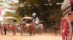 Horses with harnessed carriages in Myanmar village near Mandalay Stock Footage