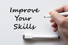 Improve your skills written on whiteboard Stock Photos