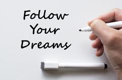 Stock Photo of Follow your dreams written on whiteboard