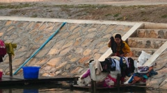 Women washing clothes at the bank of river in Myanmar Stock Footage