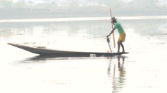 Fisher on boat in waters at Inle lake  in Myanmar with fog background Stock Footage