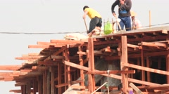 Workers build a new pagoda in Myanmar near Inle lake closeup Stock Footage