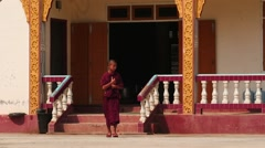 young monk going from monastery in Myanmar slow motion - stock footage